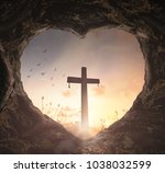 Small photo of Good Friday concept: Heart shape of empty tomb stone with the cross over meadow sunrise background