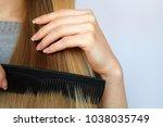 a blonde woman is doing her... | Shutterstock . vector #1038035749