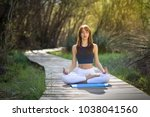 young woman doing yoga in... | Shutterstock . vector #1038041560