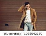 young man wearing winter... | Shutterstock . vector #1038042190