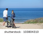 Couple With Bicycles Looking A...
