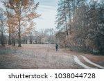 alone man walking on a rural...   Shutterstock . vector #1038044728