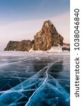 rock on freezing water lake... | Shutterstock . vector #1038046840
