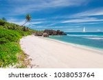 sandy beach with palm and a... | Shutterstock . vector #1038053764
