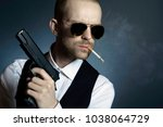 Mysterious man holding gun in...