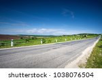 Small photo of Asphalt country road along the field in spring day