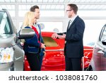 couple buying car at dealership ... | Shutterstock . vector #1038081760