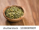 green pumkin seeds in bowl on...   Shutterstock . vector #1038089809