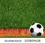 Football on green grass background - stock photo