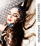 young sexy woman with leopard... | Shutterstock . vector #1038114550