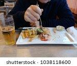 closeup of a man eat salad...   Shutterstock . vector #1038118600
