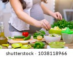Happy Pregnant Woman Cooking A...
