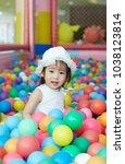 little asian girl having fun at ...   Shutterstock . vector #1038123814