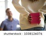 woman or girl hiding present... | Shutterstock . vector #1038126076