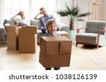 excited little boy playing with ... | Shutterstock . vector #1038126139