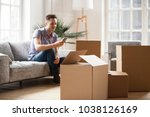 packed cardboard boxes with... | Shutterstock . vector #1038126169