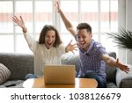 young couple feeling excited by ... | Shutterstock . vector #1038126679