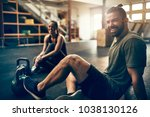 fit people in exercise gear... | Shutterstock . vector #1038130126