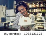 smiling young african...   Shutterstock . vector #1038131128
