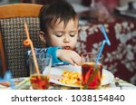 child eating fries with your... | Shutterstock . vector #1038154840