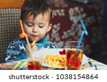 child eating fries with your... | Shutterstock . vector #1038154864