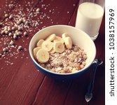 healthy breakfast. granola bowl ... | Shutterstock . vector #1038157969