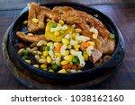 pork shops steak with bone... | Shutterstock . vector #1038162160