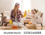 daughter and mother cleaning... | Shutterstock . vector #1038166888