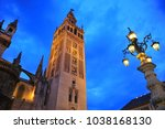 Giralda tower illuminated at sunset, Cathedral of Seville, Andalusia, Spain
