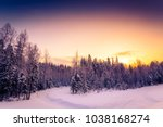 clear winter day  sunrise in a... | Shutterstock . vector #1038168274
