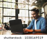 smart young asian man working... | Shutterstock . vector #1038169519