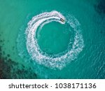 people are playing jet ski at... | Shutterstock . vector #1038171136