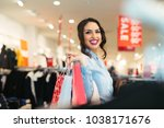 smiling girl with shopping bags ... | Shutterstock . vector #1038171676