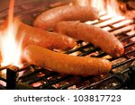 Barbecue   Grilling Sausages On ...