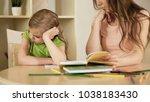 sad little girl turned away... | Shutterstock . vector #1038183430