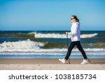 nordic walking   woman training ...   Shutterstock . vector #1038185734