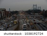 Small photo of New York, NY, USA - March 1, 2018: Evening rush hour traffic at Queens-bound lanes of the Grand Central Parkway coming off the Robert F. Kennedy (Triborough) suspension bridge.