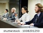 one of speakers talking to... | Shutterstock . vector #1038201253