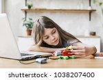 elementary student girl playing ... | Shutterstock . vector #1038207400