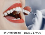 close up of a woman mouth with... | Shutterstock . vector #1038217903