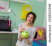 Teenage Girl Saving Money Into...
