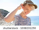 portrait of young male on rocky ... | Shutterstock . vector #1038231250