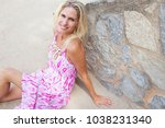 beautiful mature blond tourist... | Shutterstock . vector #1038231340