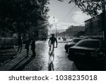 cyclist after rain   | Shutterstock . vector #1038235018