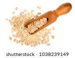 oat flakes in wooden scoop... | Shutterstock . vector #1038239149