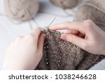 Young Woman Crochets A Warm...