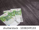 Euro Banknotes On Dark Wooden...