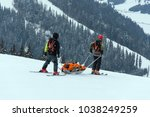 Ski Patrol Team Rescue Injured...