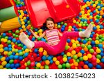 kids playing in a pool of balls | Shutterstock . vector #1038254023