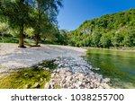 kolpa river in pobrezje ... | Shutterstock . vector #1038255700